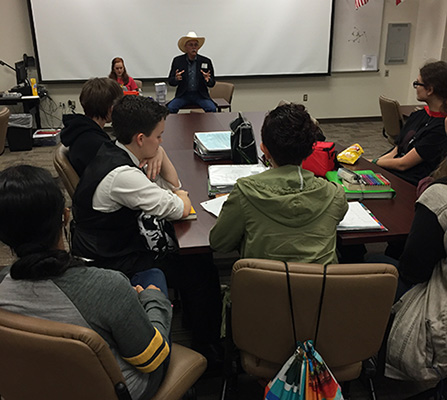 Rev talks to a class at Heritage High in Paris, TX